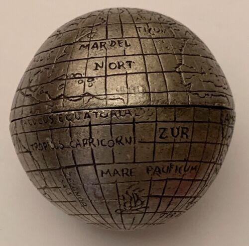 A miniature handmade metal globe, mid 20th century, with few major information.
