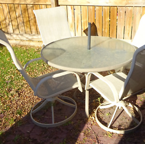 4 Chair Patio set  glass top round