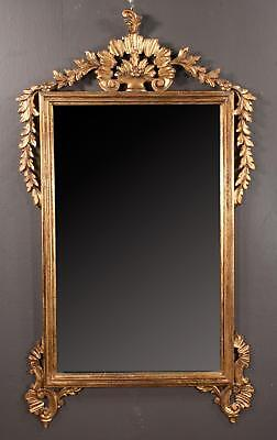 Venetian style gold gilt mirror with plume, floral and leaf carved pe... Lot 153
