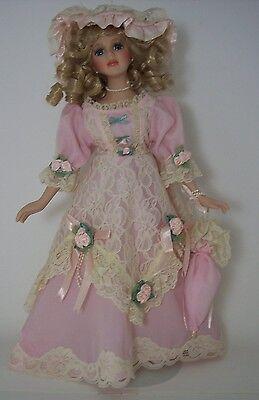 "16"" Porcelain Doll / Pink dress /blue eyes/ auburn hair"