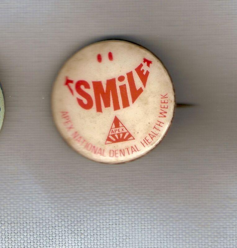 #D147.  TIN BADGE , SMILE, APEX NATIONAL DENTAL HEALTH WEEK