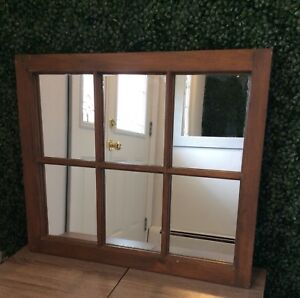 Antique wooden window with mirror