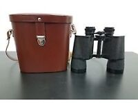 carl zeiss jena 10 x 50 multi coated jenoptem binoculars in leather case. excellent condition.