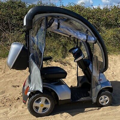 TGA Breeze S4 mobility scooter (2019) with hard canopy and flexible sides extras