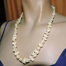 vintage carved lozenge shaped 59cm necklace unusual carved bead n Port Macquarie Port Macquarie City Preview