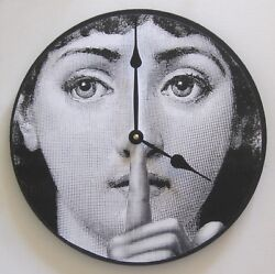 Wall clock. Fornasetti clock with iconic digital image of woman's face. Art cloc