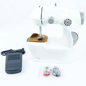 mini sewing machine electric twin speed portable mini. Black Bedroom Furniture Sets. Home Design Ideas