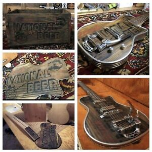 CUSTOM/RARE ELECTRIC GUITAR MADE FROM A BEER CRATE FROM THE 30s.
