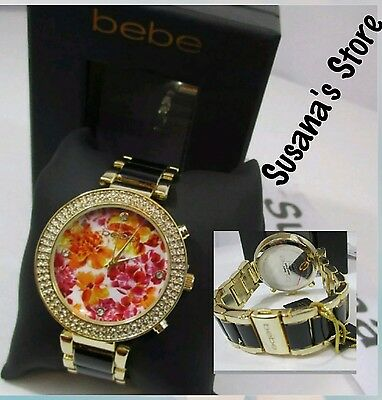 nwt bebe GOLD  FLORAL FACE WATCH Fabulous watch with a chic flora-glitter face.