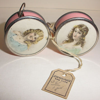 Pair Rare Antique advertising woman measuring tape Geschutzt Germany celluloid