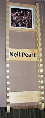 Neil Peart R 30  (Middle age) Drumstick rack with picture frame holds 20 pairs