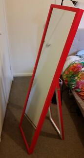 Red standing mirror in perfect condition