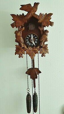 Vintage German Regula Black Forest cuckoo clock in excellent working condition.