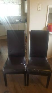 2 black leather dining chairs