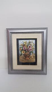 Framed 3-D composition in silver frame. New. Very nice!