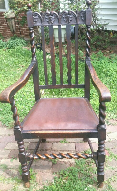 Antique Tudor Revival decorative oak armchair
