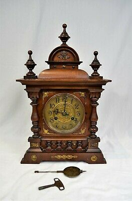 Antique carved mahogany mantel clock with brass dial & mounts 19¾