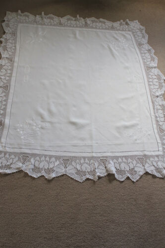 Vintage white linen tablecloth with white hand embroidery and crochet edges.