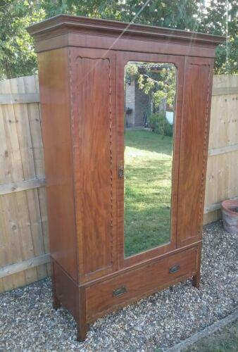 Elegant edwardian gentleman's wardrobe with shaped bevelled glass mirror drawer