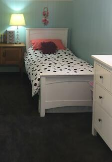 Single white bed