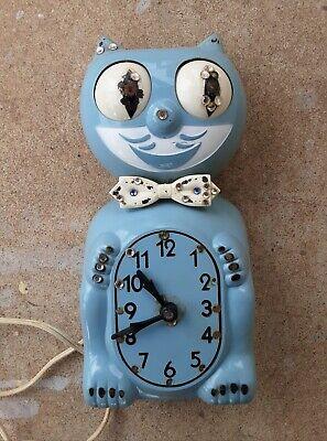 VTG LIGHT BLUE KIT CAT CLOCK RUNS! Read desc. Missing tail.