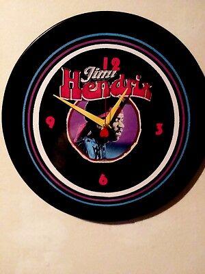 JIMI HENDRIX- 12 INCH WALL CLOCK  -  PURPLE HAZE - WIND CRIES MARY - WOODSTOCK