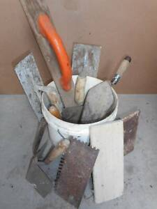 bucket of concreting and plastering tools