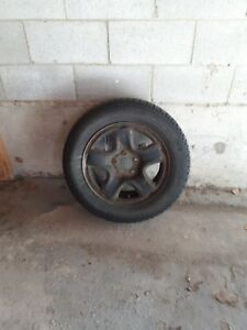 4 Winter rims and tires off 2008 Nissan Ultima