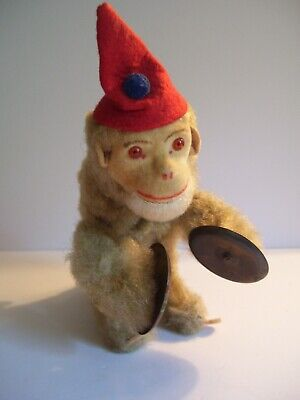 1950s Hats: Pillbox, Fascinator, Wedding, Sun Hats Vintage 1950s Wind Up Monkey in Red Hat Playing Cymbals Mechanical Toy  $24.99 AT vintagedancer.com