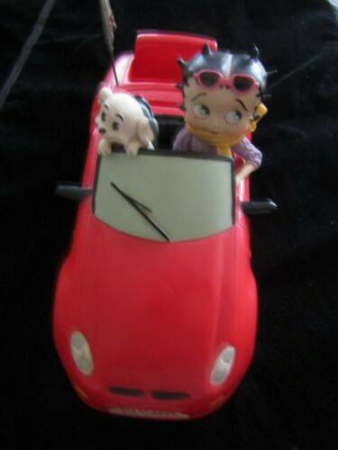 Betty Boop With Her Little Puppy Dog In Her Red Sports Car