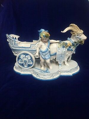 antique kpm German porcelain goat with chrub centerpiece, 19th century figure