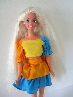 Pretty vintage  1980s/90s Barbie doll with very long hair.