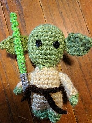 yoda star wars inspired amigurumi handmade crochet doll with lightsaber