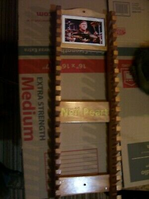 Neil Peart Old Drumstick rack with picture frame holds 20 pairs Pinewood 01