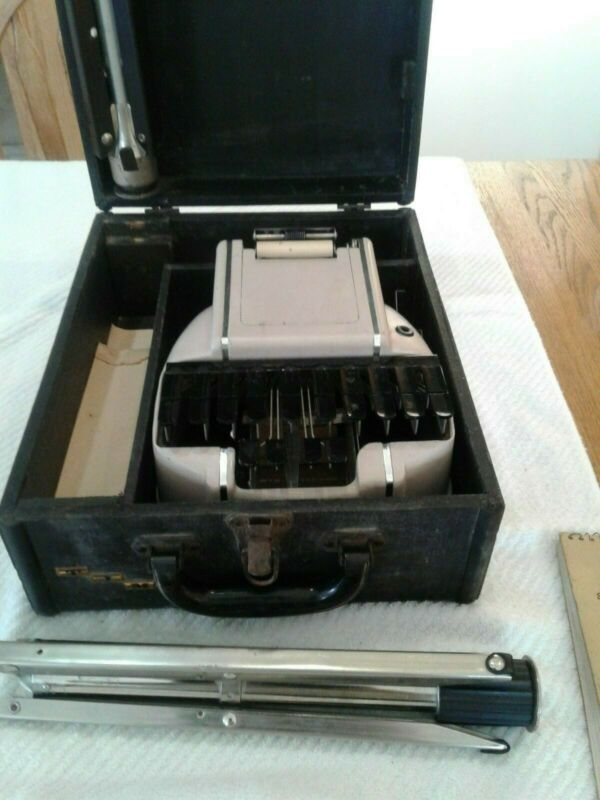 Stenographer Reporter Machine with Tripod, Books, Paper