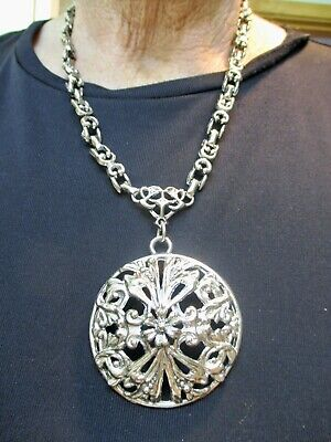 1950s Jewelry Styles and History Vintage Silver Tone 1950's Tribal Statement Necklace $14.99 AT vintagedancer.com