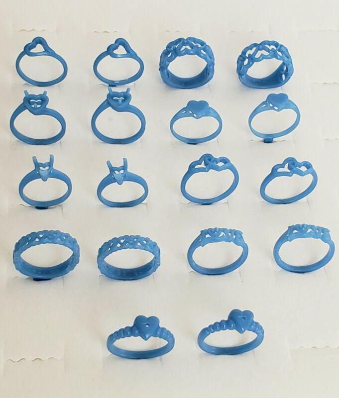 Lot of 18 wax Heart Theme Rings, assorted sizes and styles. 21-141