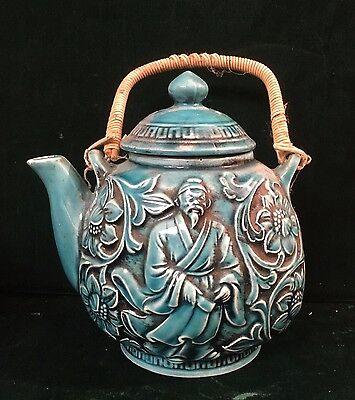 Vintage turquoise blue teapot Japanese scholar or religious figure Japan
