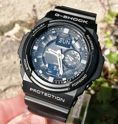 Casio G-Shock watch with box and papers.
