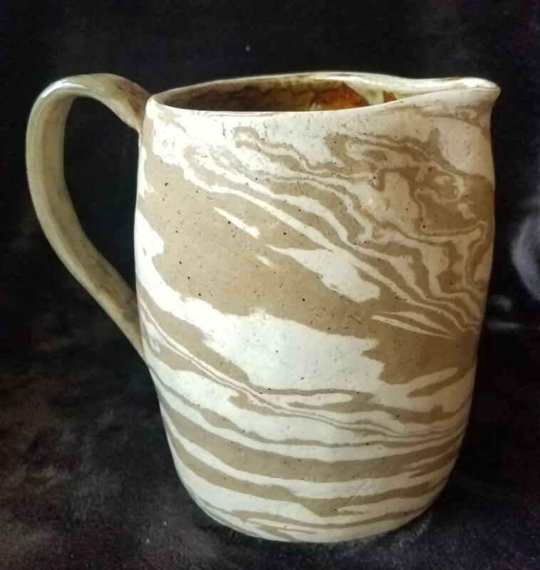 Swirl pottery pitcher with illegible stamp