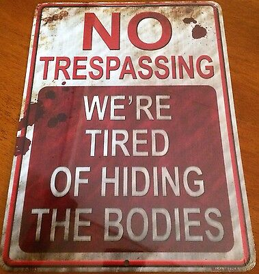 """Made in USA """"No Trespassing We're Tired of Hiding the Bodies"""" 9 x 12 Metal Sign"""
