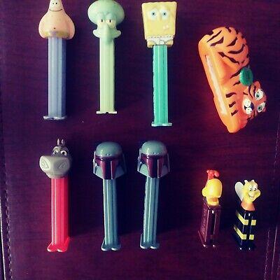 Various loose PEZ Dispensers – 6 full size, 2 mini cereal promos, 1 Pez Petz gum