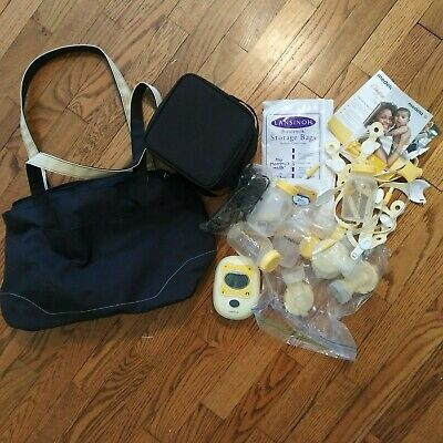 Medela Freestyle Electric Breast Pump w/AC Adapter Carrying Bag Used Sanitized