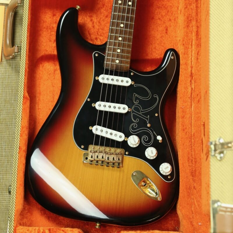 This Is A 2003 Fender Stevie Ray Vaughan Stratocaster Guitar Has Some Minor Scratches Dings Scuffs On The Body And One Chip At Back Edge Of Upper