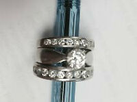 Canadian Diamonds Engagement. and 2 Diamond Bands