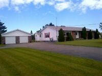 Large Bungalow with really nice landscaping with huge garage