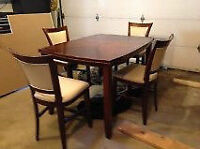 Beautiful solid wood dining room table and chairs.,