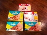 5 boxes of diapers, size 2