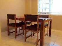 Oak Wood Dinning Table comes with 4 chairs, but fits 6 chairs