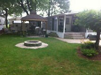 wildwood by lake..trailer, sunroom, and lot..remodeled